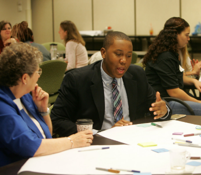 community members discuss priorities for schools