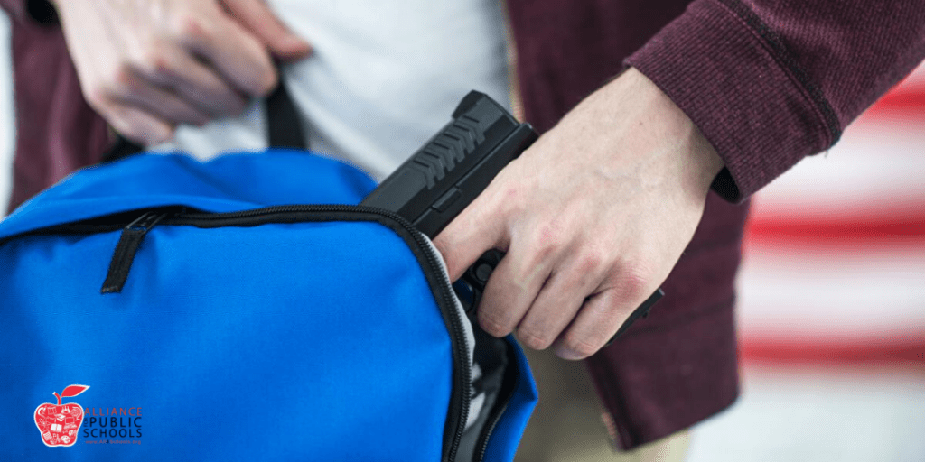 picture of gun in backpack