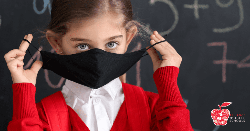 Girl with a mask and a backpack