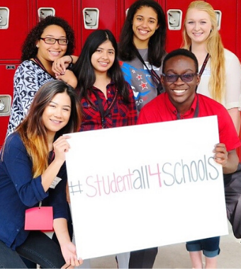 students holding a studentall4schools poster